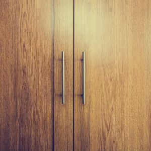 Close up of a closed wooden door brown design background texture vintage interior